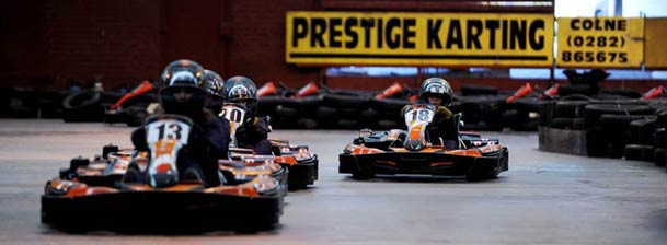 A Photo of kids Kart Racing at Prestige Indoor Karting